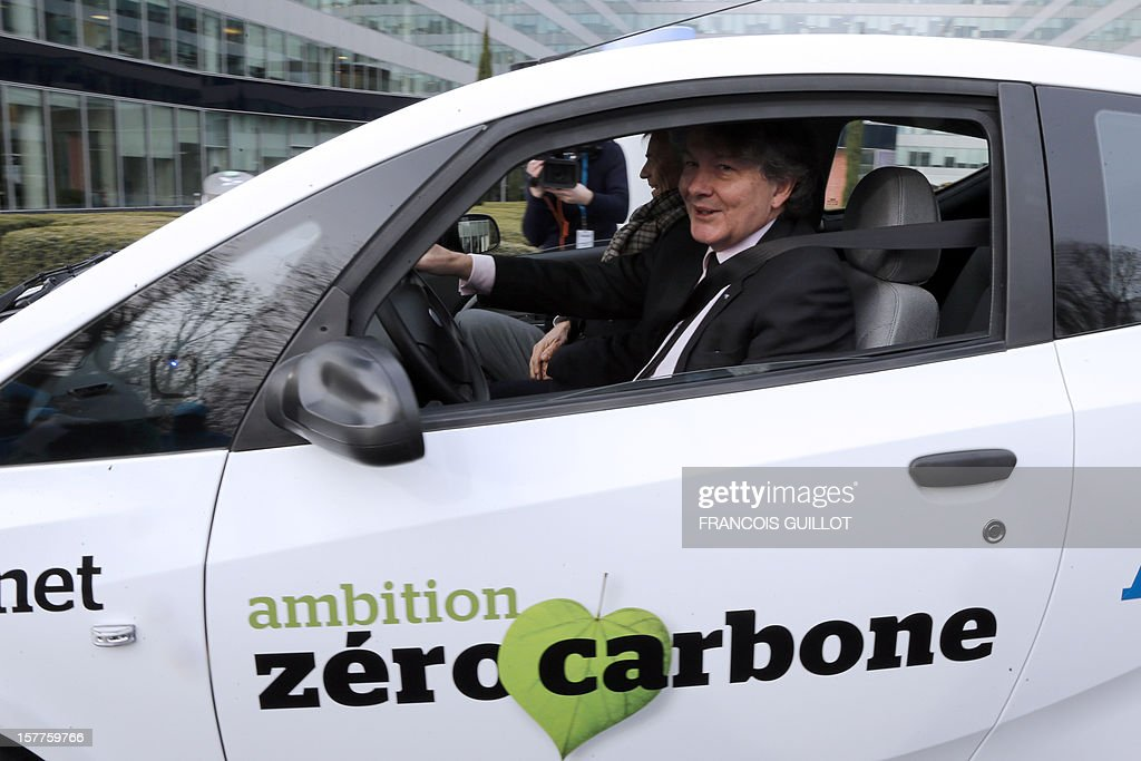 CEO of the IT services company Atos, Thierry Breton (R) drives a 'MyCar' electric car beside French industrial group Bollore's head Vincent Bollore, on December 6, 2012 in Bezons, north of Paris, after announcing during a joint press conference the launching of My Car, the first Atos electric car fleet powered by solar panels.