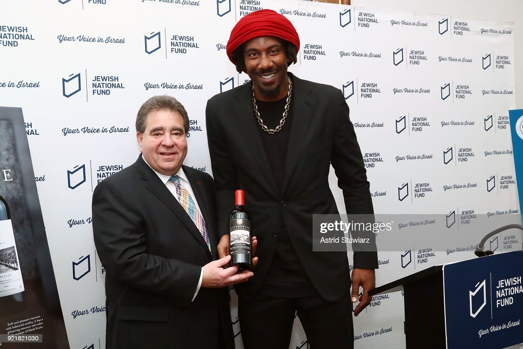 CEO of the Jewish National Fund, Russell Robinson poses for photos with Basketball player Amar'e Stoudemire during 'Stoudemire Wines' launch reception with the Jewish National Fund at Ronald S. Lauder JNF House on February 20, 2018 in New York City.