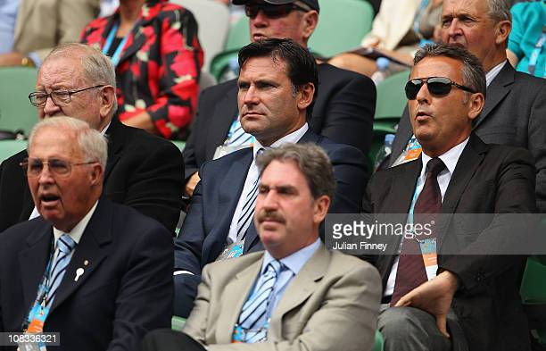 CEO of the LTA Roger Draper watches Andy Murray of Great Britain play in his quarterfinal match against Alexandr Dolgopolov of the Ukraine during day...