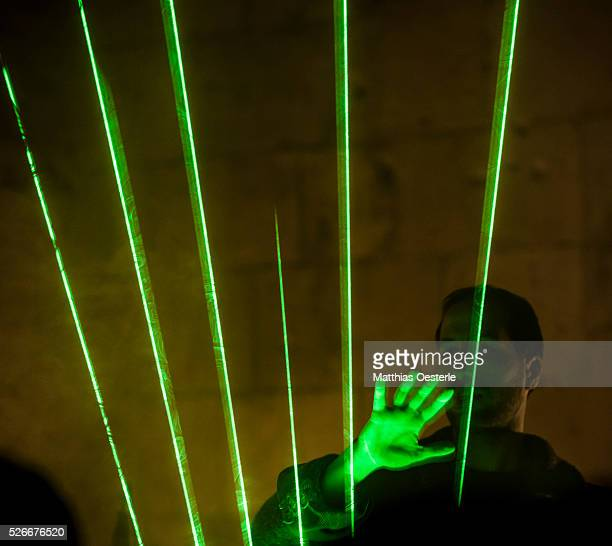 FABREGAT of the musical duo 'Kort' plays a laser harp during the city's light festival 'Llum BCN' in Barcelona