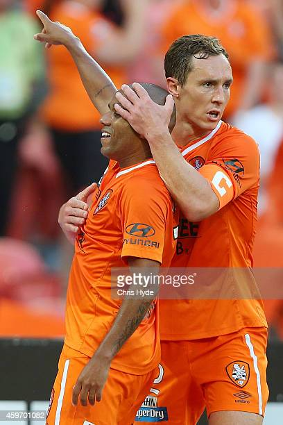 HENRIQUE of the Roar celebrates with team mate Matthew Smith after scoring a goal during the round eight ALeague match between Brisbane Roar and...