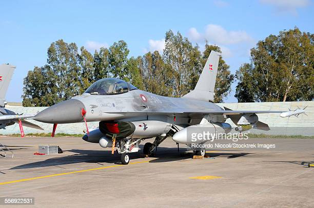 f-16a mlu of the royal danish air force armed with gbu-58 smart bombs naval air station sigonella, sicily, during operation unified protector. - airfield stock pictures, royalty-free photos & images