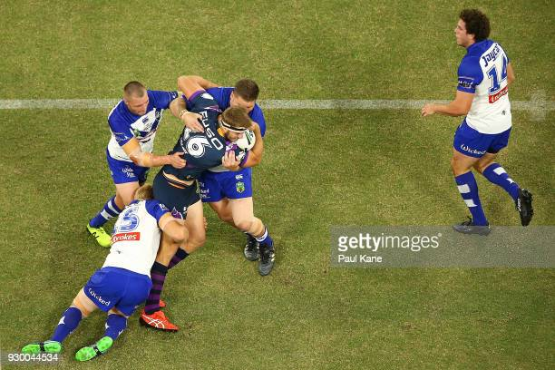 of the Storm gets tackled during the round one NRL match between the Canterbury Bulldogs and the Melbourne Storm at Optus Stadium on March 10 2018 in...