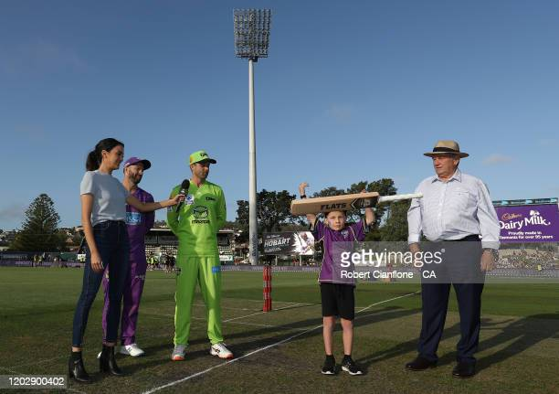 Of the Sydney Thunder and and Matthew Wade of the Hobart Hurricanes are seen at the bat flip during the Big Bash League eliminator finals match...