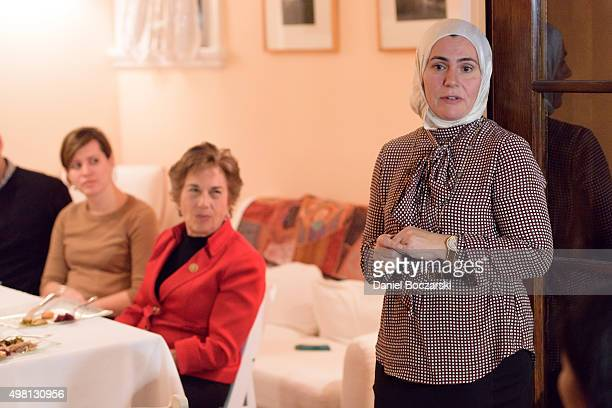 CEO of the Syrian Community Network Suzanne Akhras Sahloul speaks to Syrian refugees and community leaders during a #RefugeesWelcome Thanksgiving...