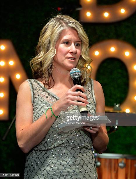 SVP of the UN Foundation Susan Myers accepts award onstage during Global Green USA's 13th annual preOscar party at Mr C Beverly Hills on February 24...