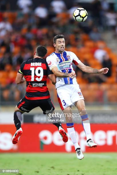 of the Wanderers and of the Jets compete for the ball in the air during the round 20 ALeague match between the Western Sydney Wanderers and the...