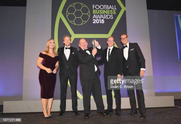 Of The Year award winner Andy Holt of Accrington Stanley poses with with presenters Hayley McQueen and Ed Chamberlin during the Football Business...