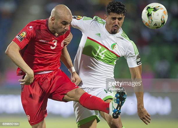ABDENNOUR of Tunisia and BAGHDAD BOUNEDJAH of Algeria during the Group B match between Algeria and Tunisia at Stade Franceville on January 19 2017 in...