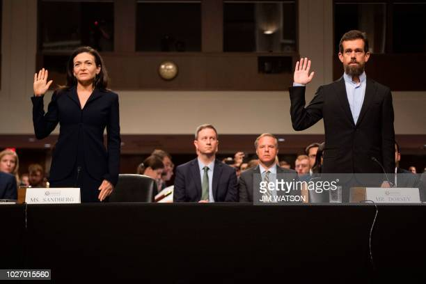 Of Twitter Jack Dorsey and Facebook COO Sheryl Sandberg are sworn in to testify before the Senate Intelligence Committee on Capitol Hill in...