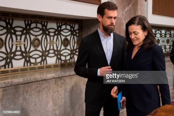 CEO of Twitter Jack Dorsey and Facebook COO Sheryl Sandberg arrive to testify before the Senate Intelligence Committee on Capitol Hill in Washington...
