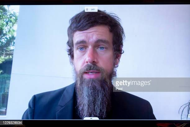 Of Twitter Jack Dorsey appears on a monitor as he testifies remotely during the Senate Commerce, Science, and Transportation Committee hearing 'Does...
