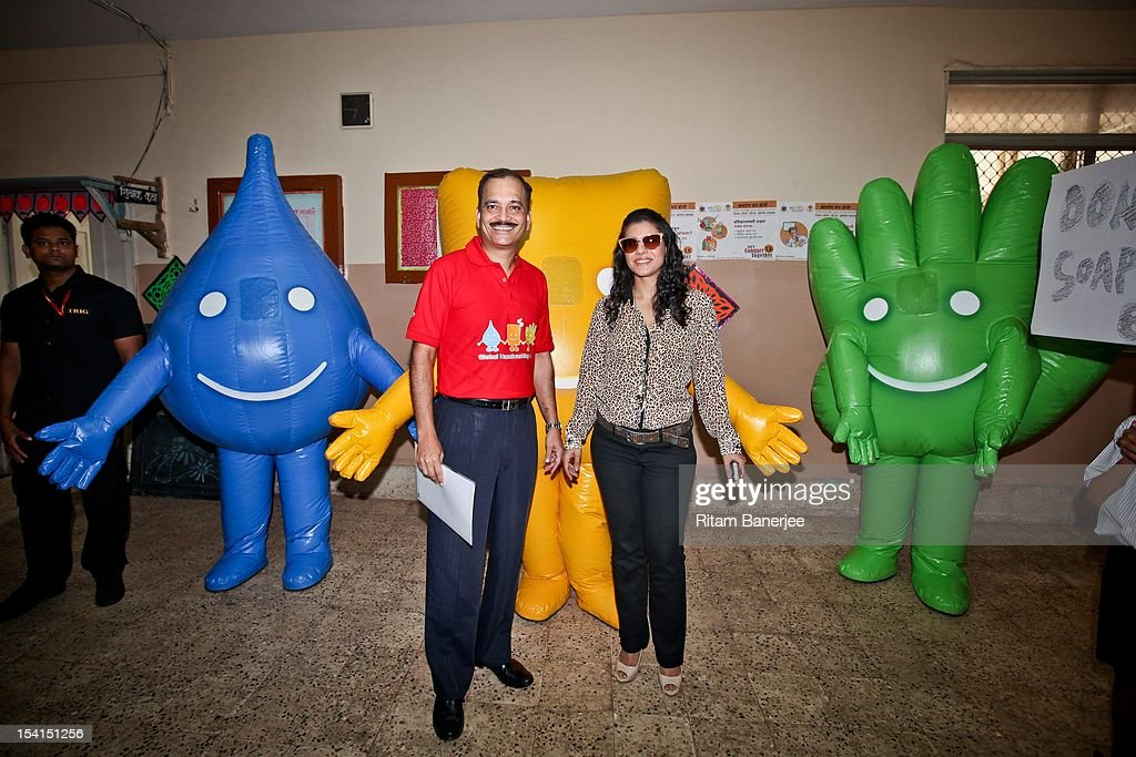 CEO MD of Unilever India Nitin Paranjpe and Bollywood actress Kajol stand alongside mascots as they attend a Global Handwashing Day event at Worli...