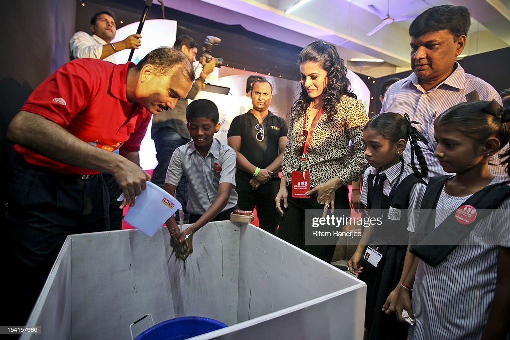CEO MD of Unilever India Nitin Paranjpe and Bollywood movie actress Kajol attend a Global Handwashing Day event at Worli Seaface Mumbai Municipal...