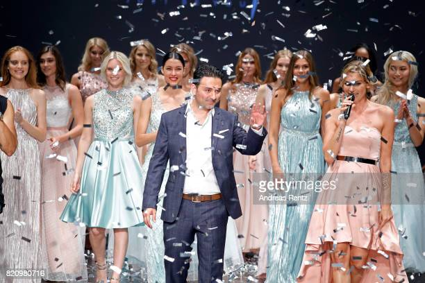 CEO of Unique Shahin Moghadam acknowledges the applause of the audience together with models at the Unique show during Platform Fashion July 2017 at...