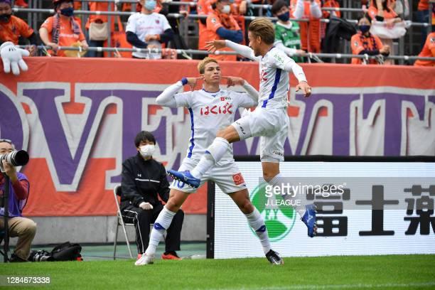 Of Ventforet Kofu celebrates scoring his side's first goal during the J.League Meiji Yasuda J2 match between Omiya Ardija and Ventforet Kofu at NACK5...