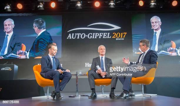 CEO of Volkswagen AG Matthias Mueller talks with Gabor Steingart publisher of German economy paper Handelsblatt and the paper's chief editor Sven...