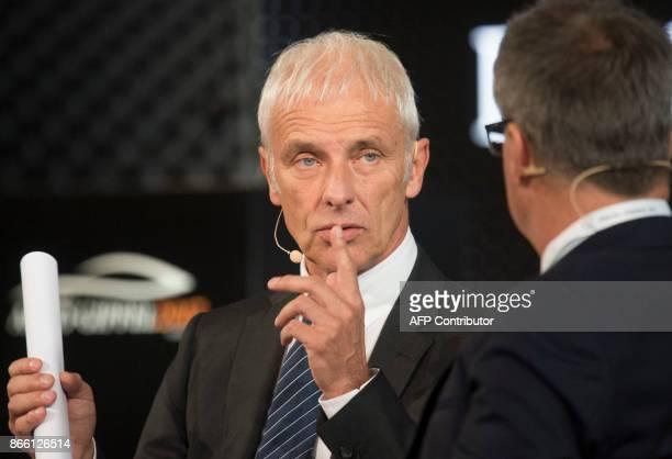 CEO of Volkswagen AG Matthias Mueller talks with Gabor Steingart publisher of German economy paper Handelsblatt during the Auto Gipfel 2017 at the...