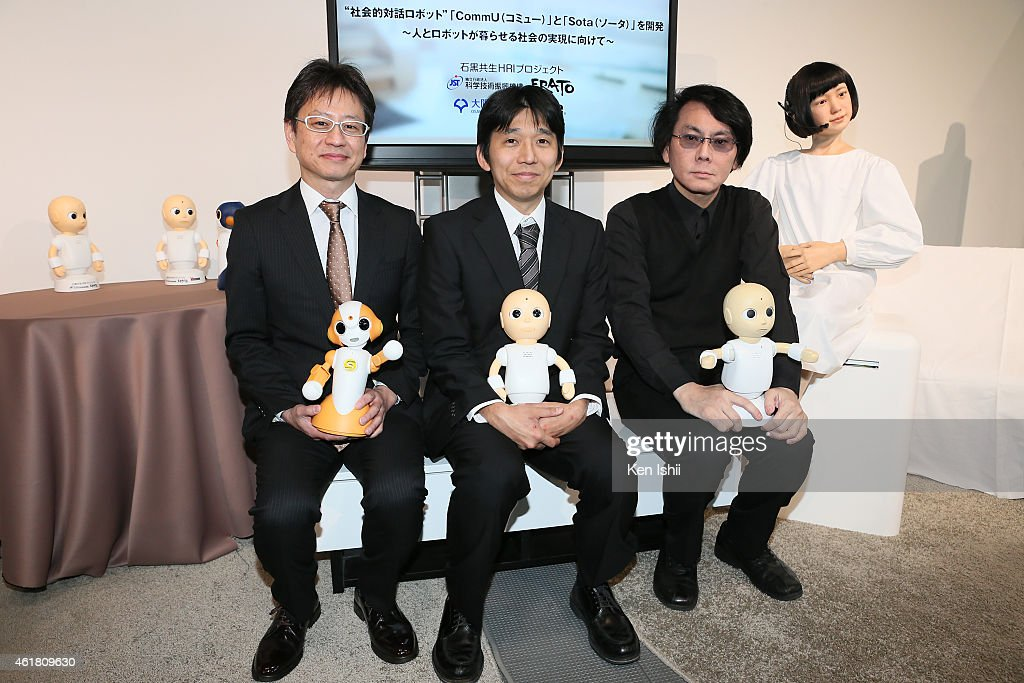 CEO of Vstone Ltd., Nobuo Yamato, associate professor Yuuichiro Yoshikawa and professor Hiroshi Ishiguro pose with communication robot for photographs during the press conference to introduce the sociable robots, 'CommU' and 'Sota' hosted by only the robot science communicator Otonaroid and the robot anchor Kodomoroid at the National Museum of Emerging Science and Technology (Miraikan) on January 20, 2015 in Tokyo, Japan. CommU and Sota, developed to improve humanoids' sense of interaction in dialogue, make people feel more engaged in conversation with them by featuring diverse eye movements and gaze directions.