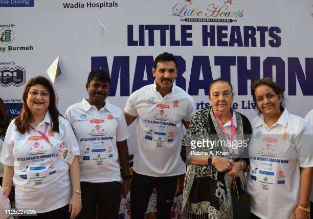 CEO of Wadia Hospitals Dr Minnie Bodhanwala Vishvas Mote John Abraham and his mother Firuza Irani and Dr Panda at the sixth edition of the Britannia...