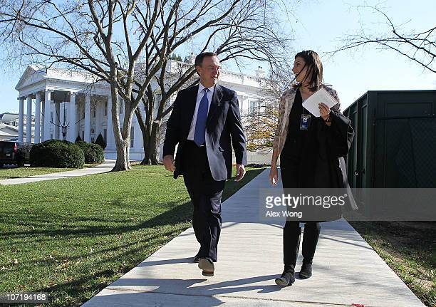 CEO of Walmart Mike Duke is escorted by an unidentified staff as he leaves the White House after a meeting with President Barack Obama November 29...