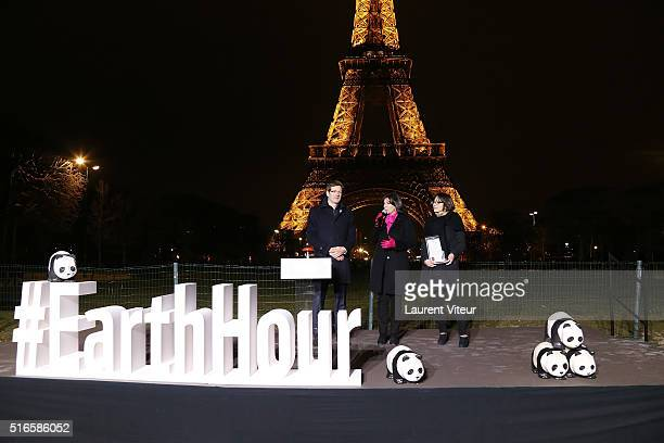 Of WWF France Pascal Canfin, Mayor of Paris Anne Hidalgo and Deputy mayor in charge of the environment Celia Blauel attend Lights Tour Eiffel turn...