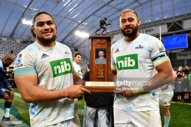 Ofa Tu'ungafasi and Patrick Tuipulotu of the Blues hold the Gordon Hunter Memorial Trophy after winning the round 8 Super Rugby Aotearoa match...