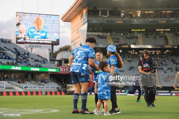 Ofa Tuungafasi of the Blues spends a moment with his daughters before running on in his 100th game during to the round 6 Super Rugby Aotearoa match...