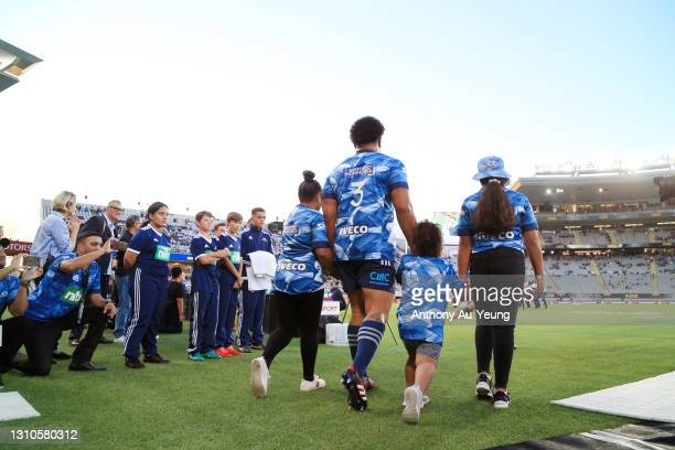 Ofa Tuungafasi of the Blues walks out the tunnel on to the field with his daughters on his 100th game during the round 6 Super Rugby Aotearoa match...