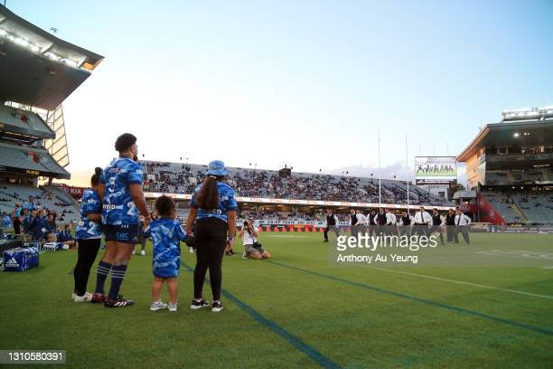 Ofa Tuungafasi of the Blues watches with his daughters as a haka is performed for his 100th game during the round 6 Super Rugby Aotearoa match...