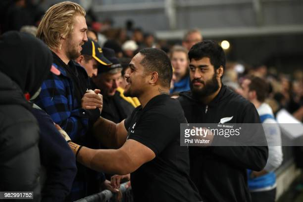 Ofa Tu'ungafasi of the New Zealand All Blacks meets with fans following the International Test match between the New Zealand All Blacks and France at...