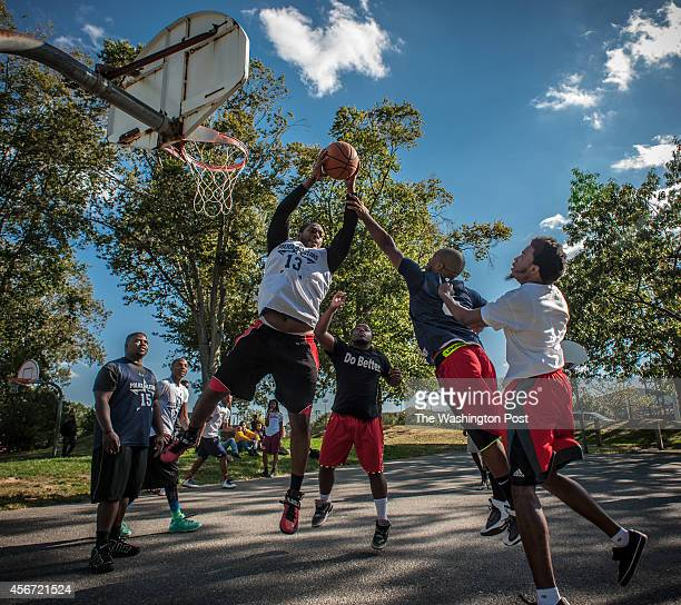 Ofc Terrence Garrett PGPD pulls down a rebound as Do Better President Gregory Brown Ofc Calvin Brinkley and Colin Byrd with the campus BSU and NAACP...