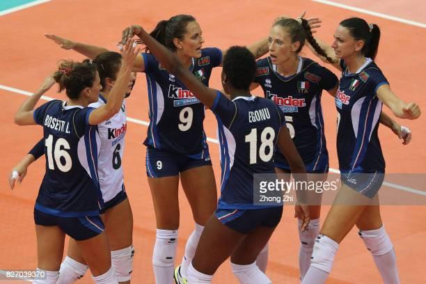 Ofelia Malinov #6 Moncia De Gennaro #7 Raphaela Folie #9 Caterina Bosetti and team mates of Italy celebrate a point during the final match between...