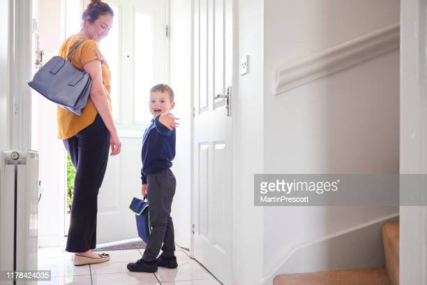 off for his first day at school - shoulder bag stock pictures, royalty-free photos & images