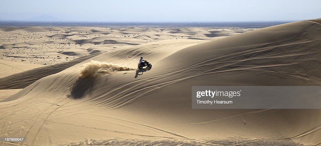 Off highway vehicle/OHV enthusiast on the dunes : Stock Photo