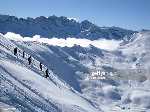 Off piste skiers at the Pointe de Mossette, Morzine in the French Alps.