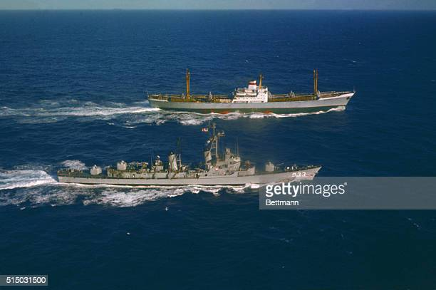 Off Puerto Rico: U. S. S. Barry Alongside Ansov. The U. S. S. Barry steams alongside the Soviet freighter Ansov, outbound from Cuba, for an...