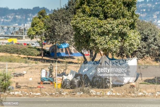 off ramp homeless camp - homeless shelter stock pictures, royalty-free photos & images