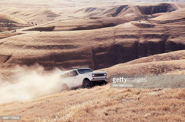 Off road drive with dust trail
