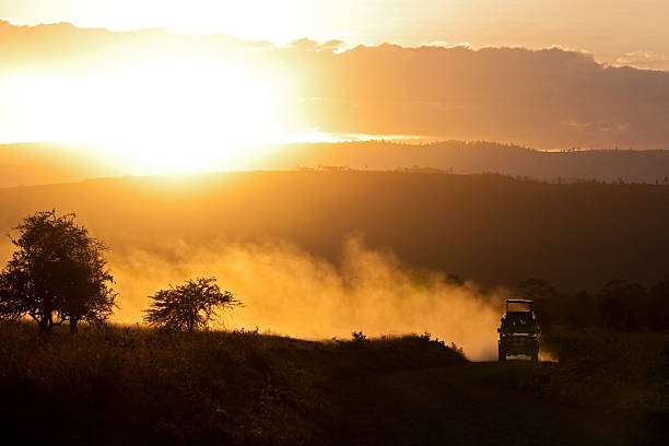 Off road vehicle at sunset
