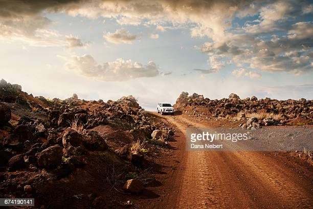 off road vehicle on a red dirt road. - jeep stock pictures, royalty-free photos & images