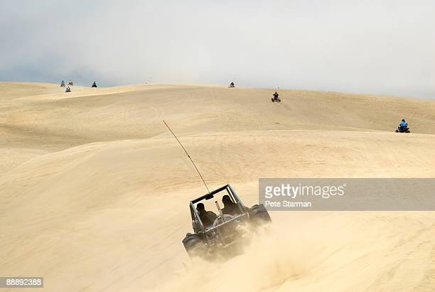 off road vehicles at pismo beach dunes.. - pismo beach stock pictures, royalty-free photos & images