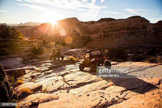 Off road vehicles driving a rock path in Moab.