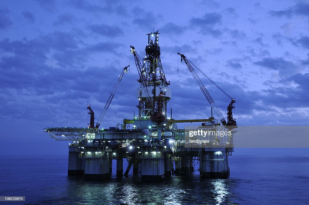 Off Shore Drilling Platform at Twilight. Oil rig and reflection : Stock Photo