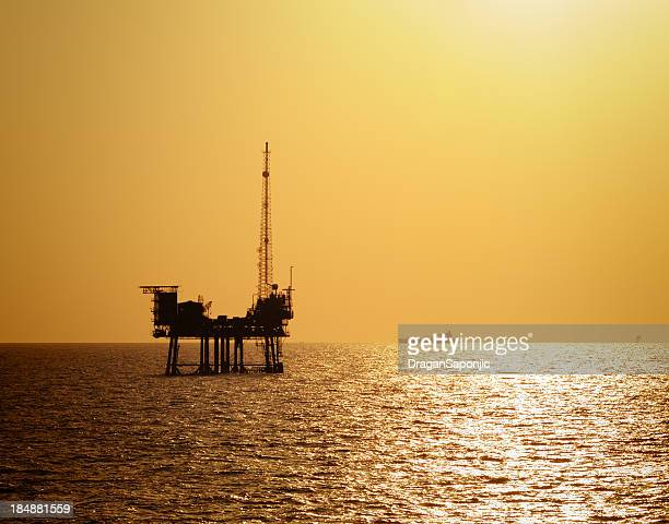 Off shore oil rig at sunset