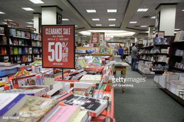 A 50% off sign for books at Barnes and Noble