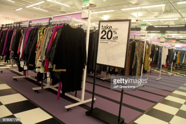A 20% off sign inside Bloomingdale's The Outlet Store