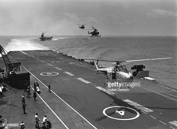 Off the coast of Malaysia the HMS Eagle HMS Bulwark and the HMS Victorious along with other units of the Royal Navy and Royal Australian Navy...
