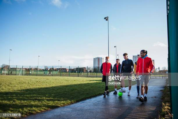 off to play - training grounds stock pictures, royalty-free photos & images