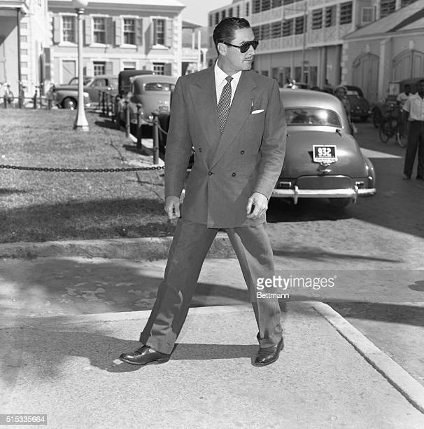 Off to the Courtroom Nassau Bahamas Sungoggled film swashbuckler Errol Flynn enters the Supreme Court Building in Nassau where he is appearing in a...